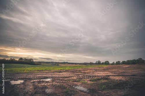 Foto auf Gartenposter Landschappen Landscape with wheel tracks on a muddy field