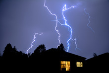 Urban Rooftop Electric Lightning Strike In Evening Thunder Storm