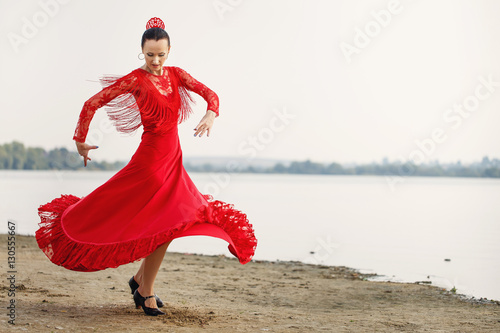 Fototapeta  Flamenco dancer Spain womans in a long red dress