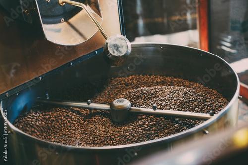Roasted coffee in  roaster Fototapeta