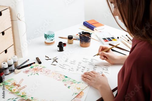 Girl writing calligraphy on postcards. Art design. Canvas
