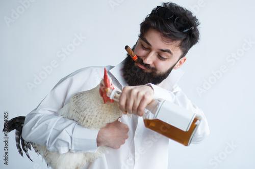 Fotografering  drunk crazy man with chicken
