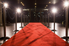 Long Red Carpet Between Rope B...