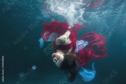Fotografia, Obraz  In the pool underwater dancing girl, she in a red dress.
