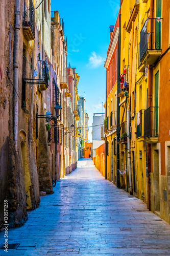Canvas Prints Narrow alley view of a colorful narrow street in the historical center of spanish city tarragona