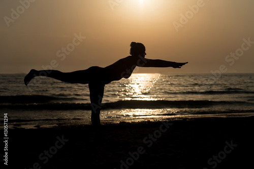 Printed kitchen splashbacks Panther Young Woman Practicing Yoga on the Beach
