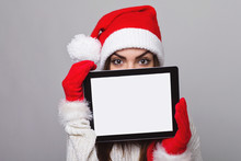 Young Santa Woman Holding Tablet With Blank Screen