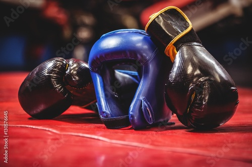 Boxing headgear and gloves in boxing ring Wallpaper Mural