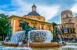 Square of Saint Mary's with Valencia Cathedral Temple, Basilica de la nuestra senora de los desamparados and the rio tura fountain in old town.