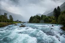 Misty Landscape With Oldeelva Glacier River In Norway