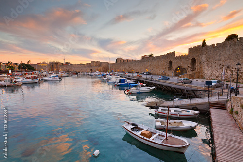 Old harbor and city walls of the medieval town of Rhodes.