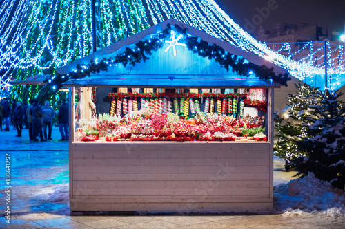 Sales of traditional Christmas sweets on the Christmas fair Canvas Print
