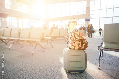 Fotografie, Obraz  travel luggage with passenger blur background in airport terminal with vintage t