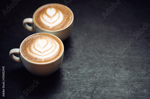 Fotografie, Obraz  Two cups of coffee on black rustic background