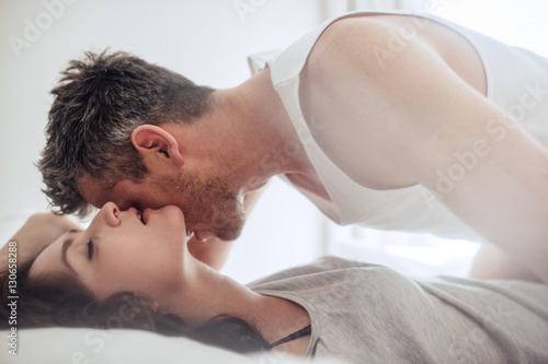 Passionate and romantic couple enjoying foreplay Wallpaper Mural