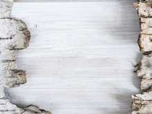 Piece Of Birch Bark On A Wooden Plank With Copy Space For Text O