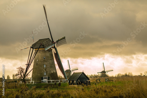 Photo sur Toile Moulins Historians Dutch windmills near Rotterdam
