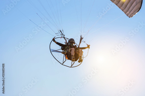 paraglider flying  with paramotor