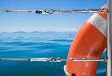 Orange Safety Flotation Device On The Side Of A Boat