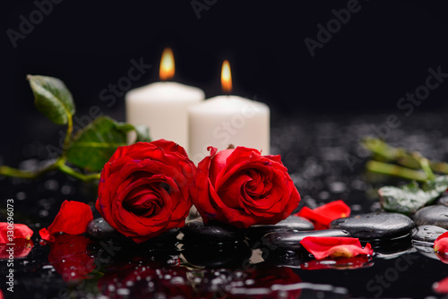 Staande foto Spa Two red rose with candle ,green leaf and therapy stones