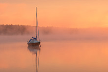 Sailboat In Morning Light And Mist
