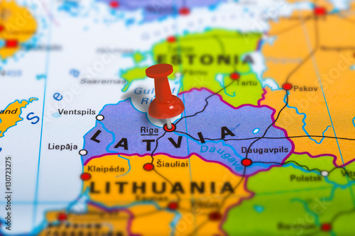Riga Latvia pinned on colorful political map of Europe. Geopolitical school atlas. Tilt shift effect.