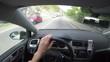 man drives modern car - checks gps on the smartphone - driver view