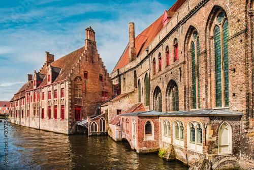 In de dag Brugge Historical brick buildings along beautiful canals in spring in Bruges, Belgium
