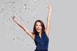canvas print picture - Beautiful happy woman at celebration party with confetti falling everywhere on her. Birthday or New Year eve celebrating concept