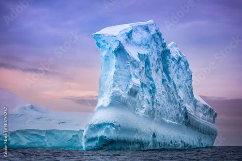 Ingelijste posters Antarctica Antarctic iceberg in the snow floating in open ocean. Blue sunset sky in the background. Beauty world