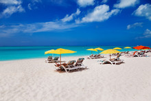 Lounge Chairs And Beach Umbrellas On Grace Bay Beach