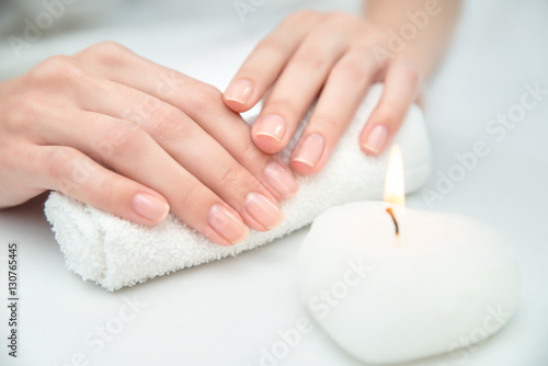 Woman getting nail manicure.