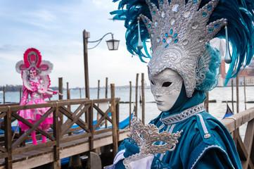 Obraz na płótnie Canvas Venice carnival masks at the Grand Canal