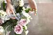 canvas print picture - Female florist making beautiful bouquet at flower shop