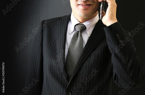Fotografie, Obraz  電話するビジネスマン