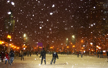 Winter Night In Chicago. People Enjoying Ice Skating At Millennium Park Ice Rink During Snowy Night In Chicago.
