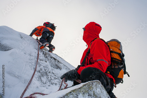 Mountaineering. Teamwork in alpinism. Traverse of mountain.
