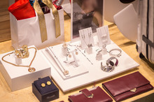 Various Accessories In A Shop: Bracelets, Wallets, Earrings, Necklaces.