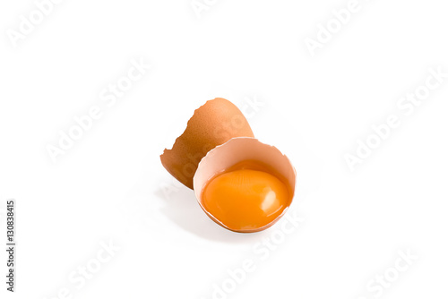 Poster Chicken Egg yoke in cracked eggshell isolated on a white background