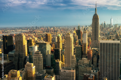Fototapety, obrazy: NEW YORK CITY: Observers view Midtown from Top of the Rock Rockefeller center. Manhattan is often described as the cultural and financial capital of the world.