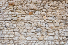 Stone Wall Of A Ancient Fortress With White Blocks