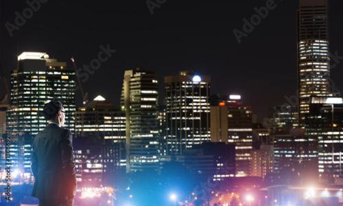 Fototapety, obrazy: Businessman viewing night glowing city