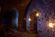 Dungeon Under The Old German Fortress Illuminated By Lantern And Candles