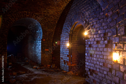 Dungeon under the old german fortress illuminated by lantern and candles Fototapet