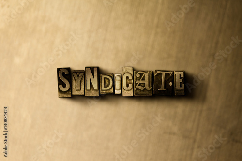 Photo  SYNDICATE - close-up of grungy vintage typeset word on metal backdrop