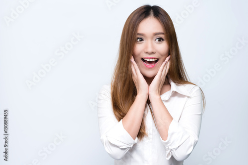 Fotografia  Young beautiful smiling Asian woman express surprised and excited