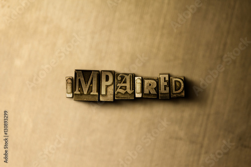 Valokuva  IMPAIRED - close-up of grungy vintage typeset word on metal backdrop