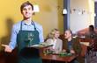 waiter working in restaurant