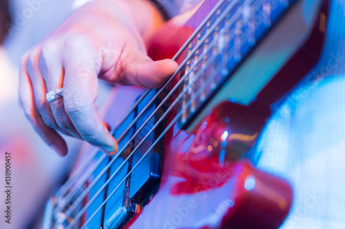 Fényképezés  Hands of a musician playing an electric guitar.