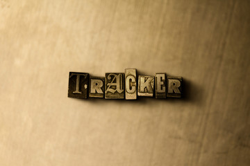 TRACKER - close-up of grungy vintage typeset word on metal backdrop. Royalty free stock - 3D rendered stock image.  Can be used for online banner ads and direct mail.